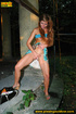Redhead in blue raises her top and skirt to expose…