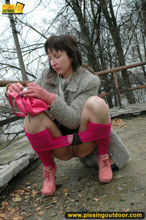 Girl in bright shows no shame as she bends to show pussy and pee right on the road - XXXonXXX - Pic 1