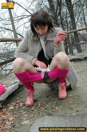 Girl in bright shows no shame as she bends to show pussy and pee right on the road - XXXonXXX - Pic 9