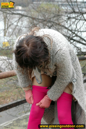 Girl in bright shows no shame as she bends to show pussy and pee right on the road - XXXonXXX - Pic 15
