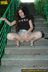 Hot chick raises short skirt to piss on steps before cleaning pussy on
