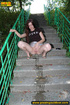 Hot chick raises short skirt to piss on steps…