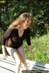Cute naughty chick on a stroll stops to bend on…
