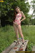 Pretty sexy chick on a walk in the forest finds an old table to piss on