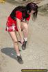 Hot girl in red raises short red skirt to piss hot…