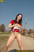 Hot girl in red raises short red skirt to piss hot…