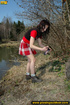 Young girl in sexy red dress in woods expose butt…