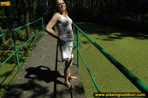 Seductive looking babe on a stroll raises clothes to pee out in the park - XXXonXXX - Pic 9