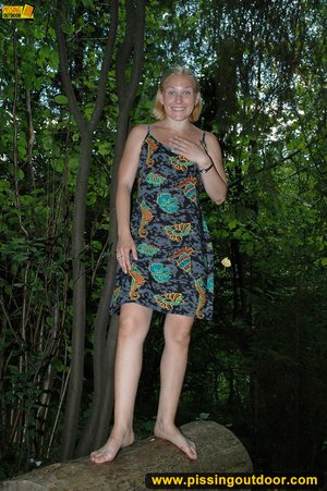 Horny blonde in cute short skirt takes walk in woods and pisses on tree trunk - XXXonXXX - Pic 1