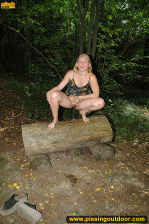Horny blonde in cute short skirt takes walk in woods and pisses on tree trunk - XXXonXXX - Pic 5