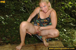 Horny blonde in cute short skirt takes walk in woods and pisses on tree trunk - XXXonXXX - Pic 9