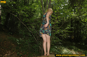 Horny blonde in cute short skirt takes walk in woods and pisses on tree trunk - XXXonXXX - Pic 12