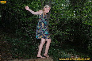 Horny blonde in cute short skirt takes walk in woods and pisses on tree trunk - XXXonXXX - Pic 17