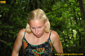 Horny blonde in cute short skirt takes walk in woods and pisses on tree trunk - XXXonXXX - Pic 18
