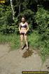 Lady in bikini removes panty along walkway in…