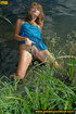 Cute girl in blue having fun in the water comes out to bend over to piss
