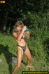 Cute girl in blue having fun in the water comes…