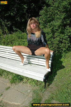 Pretty girl goes naughty pissing on white public bench close to forest - XXXonXXX - Pic 8