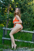 Nasty chick with long hair takes off her orange…