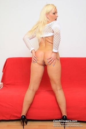 Hot slutty blonde on sofa shows pussy and she fucks herself with long sex toy - XXXonXXX - Pic 6