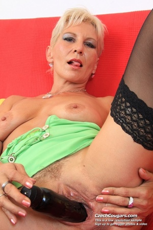 Hot sexy grandma with short blonde hair reveals pussy and fucks big black dildo - XXXonXXX - Pic 3