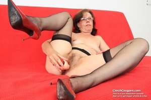 Matured chick in glasses shows hairy matured pussy, sucks dildo and puts in pussy - XXXonXXX - Pic 1