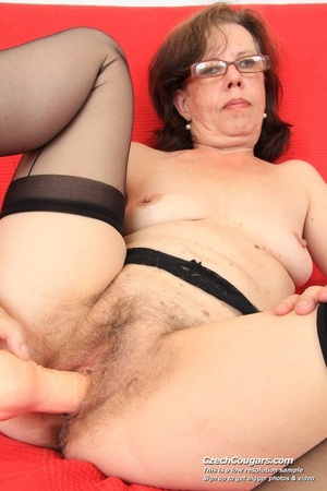 Matured chick in glasses shows hairy matured pussy, sucks dildo and puts in pussy - XXXonXXX - Pic 2