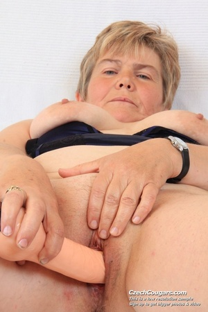 Slutty grandma with big tits feeling naughty opens and masturbates with sex toy - XXXonXXX - Pic 1