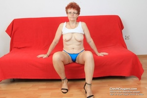 Red hair granny shows tits and hairy pussy before masturbating with long dildo - XXXonXXX - Pic 1