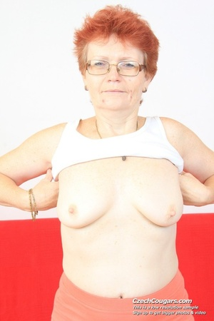 Red hair granny shows tits and hairy pussy before masturbating with long dildo - XXXonXXX - Pic 2