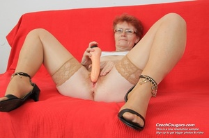 Red hair granny shows tits and hairy pussy before masturbating with long dildo - XXXonXXX - Pic 3