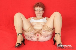 Red hair granny shows tits and hairy pussy before masturbating with long dildo - XXXonXXX - Pic 6