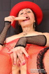 Naughty mom in red hat and pantyhose opens pussy…