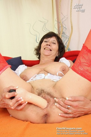Bold and wild momma shoves in long dildo as she reveals pussy and cute tits - XXXonXXX - Pic 2