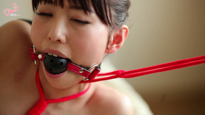 Pretty young Asian babe in red restraints gets tickled and pleasured erotically - XXXonXXX - Pic 2