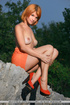 Lovely orange girl shines in her back yard after…