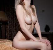 Amazing blonde seduces with her soft blue eyes