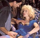 Classy eighties lady in blue stockings enjoys a…