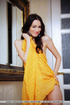 Cosmopolitan brunette drops her yellow wrap to…