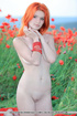 Redhaired hottie gives an extreme close-up of her two lips in the tulips