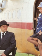 A retro flight attendant enjoys screwing - XXX Dessert - Picture 2