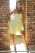 Tasty young chick in yellow dress strips to reveal…
