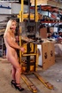 Innocent blonde sex-slave bondaged on a forklift…