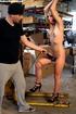 Innocent blonde sex-slave bondaged on a forklift gets her tight wet pussy