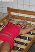 Struggling blonde gets tied to a bed frame and…