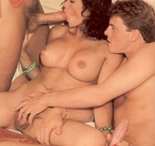 A very cute retro horny babe banged by two men…