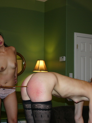 Randy redhead bending over to get her gorgeous ass spanked by a cute asian. - XXXonXXX - Pic 15