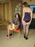 These two curvy milfs get their big booties spanked by a randy black haired