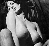 Playful busty vintage beauty smoking and…