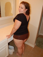 Tattoed bbw milf slowly taking off her undies in front - Picture 1